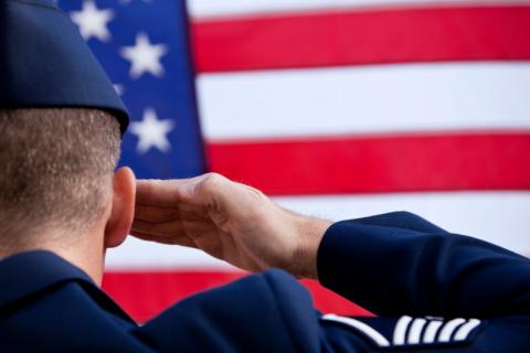 soldier saluting the US flag